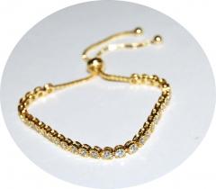 Золотой браслет с камнями